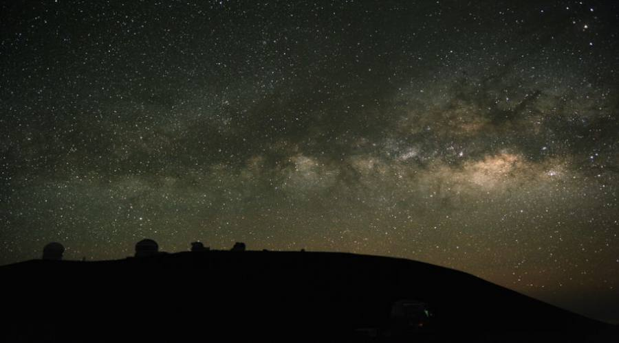 Telescopes observe the Milky Way. These are on Mauna Kea