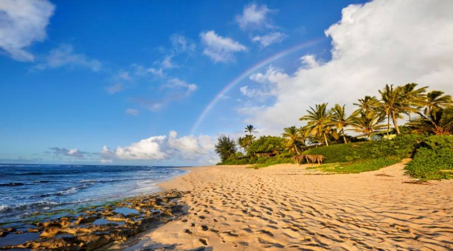 rainbow scenic view over the popular surfing place Sunset Beach, North Shore, Oahu